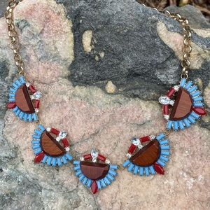 Statement necklace in gold, blue, red, wood